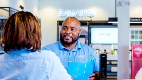 Xfinity store employee speaking to customer