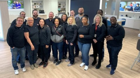 group of Comast employees inside new Lancaster Xfinity Store