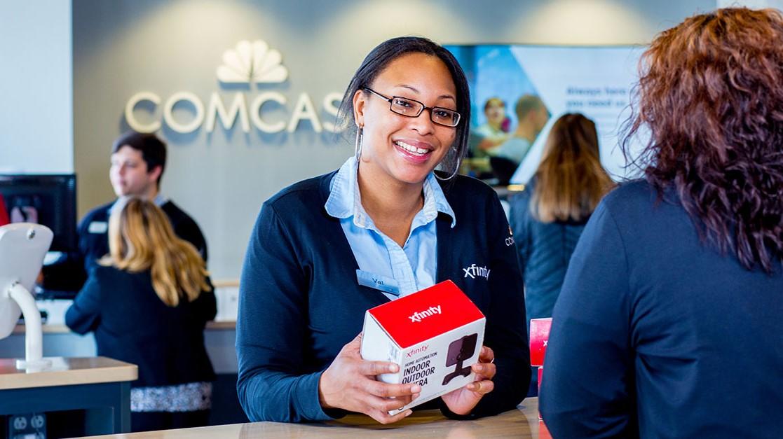 A retail associate helps a customer